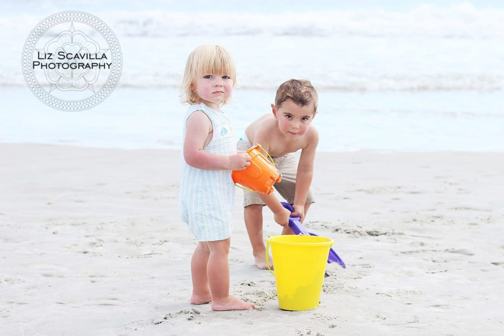 Sons Playing On Beach