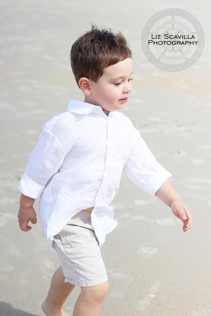 Boy Walking Along the Beach
