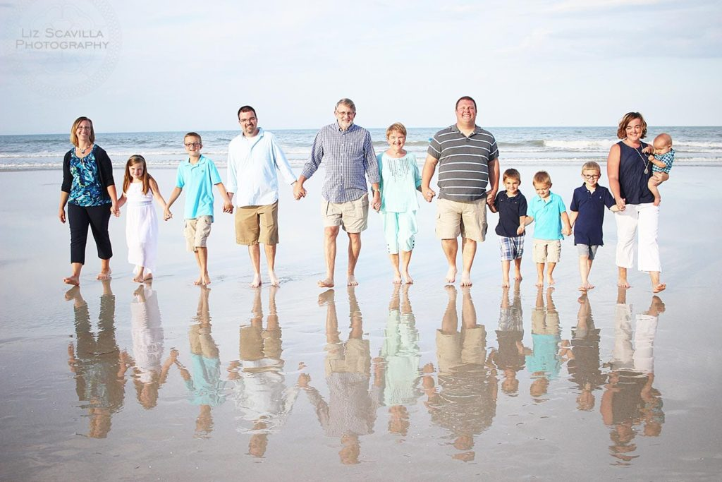 Family beach shoot water reflection