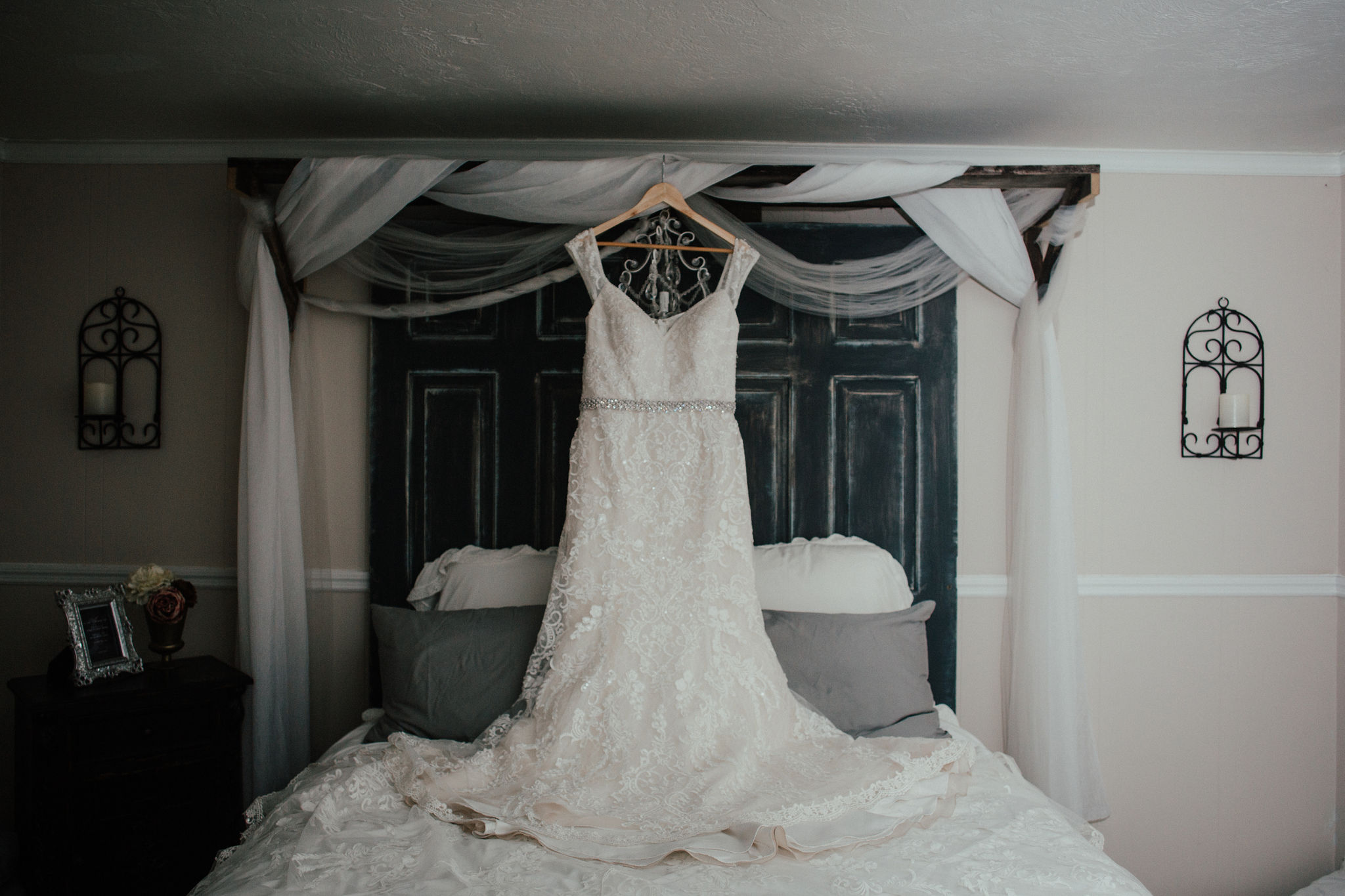 The bride's gorgeous dress hanging in the master bedroom at Bridle Oaks.