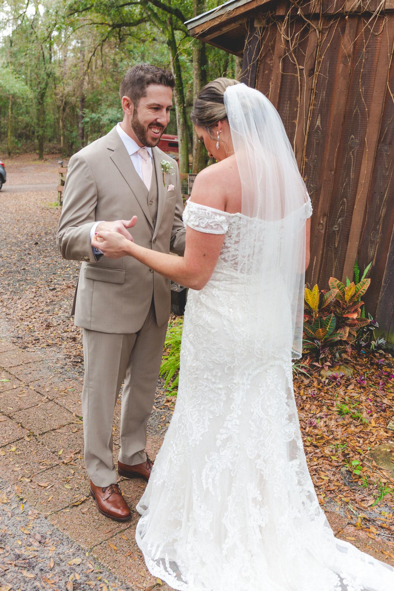 Groom admiring his gorgeous bride.