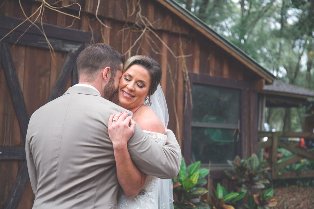 The bride and groom embracing at their first look before the ceremony.