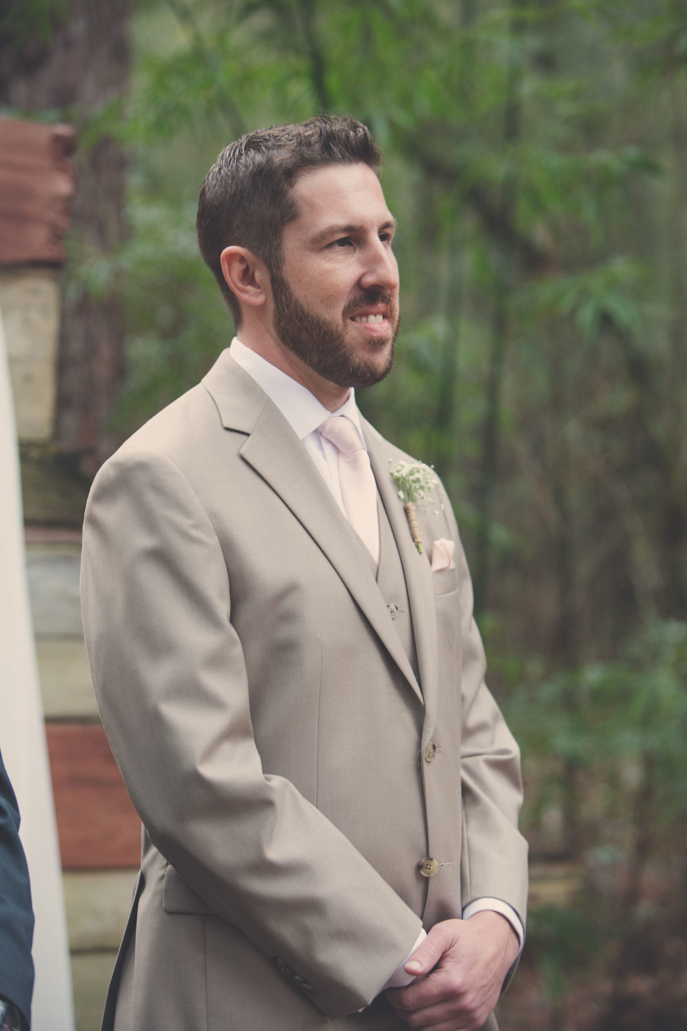 The groom waiting for his bride to walk down the aisle.