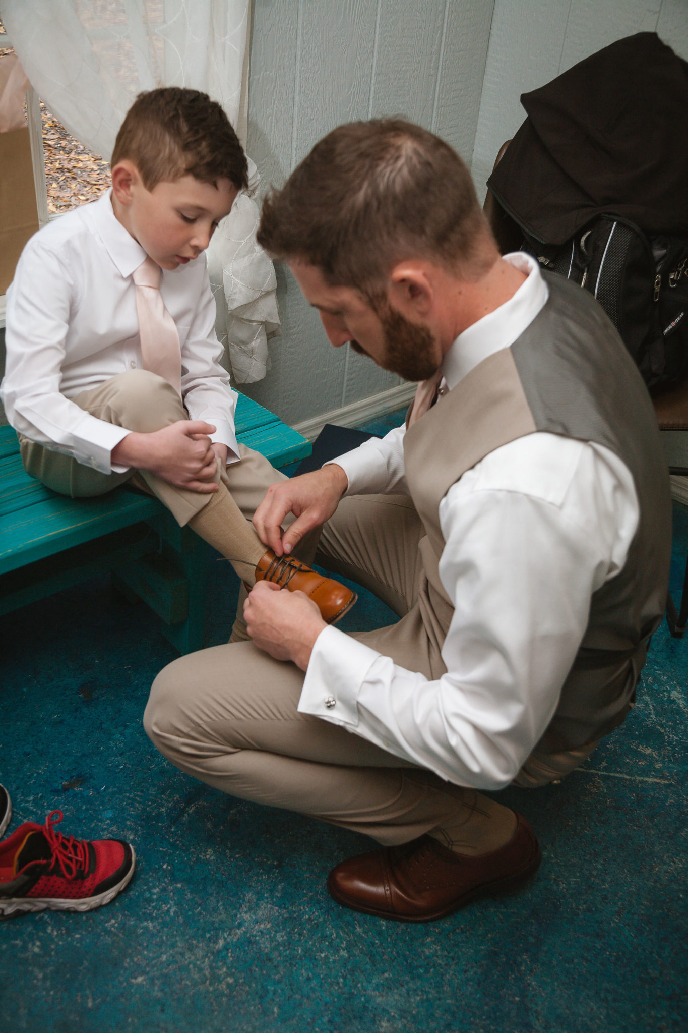 The groom and his son getting ready.
