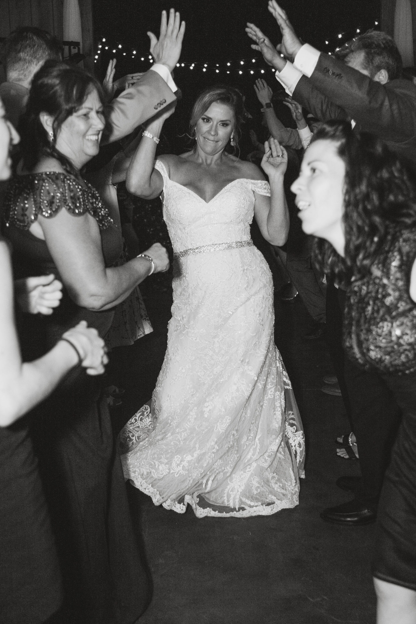 The bride rocking out with her wedding guests.