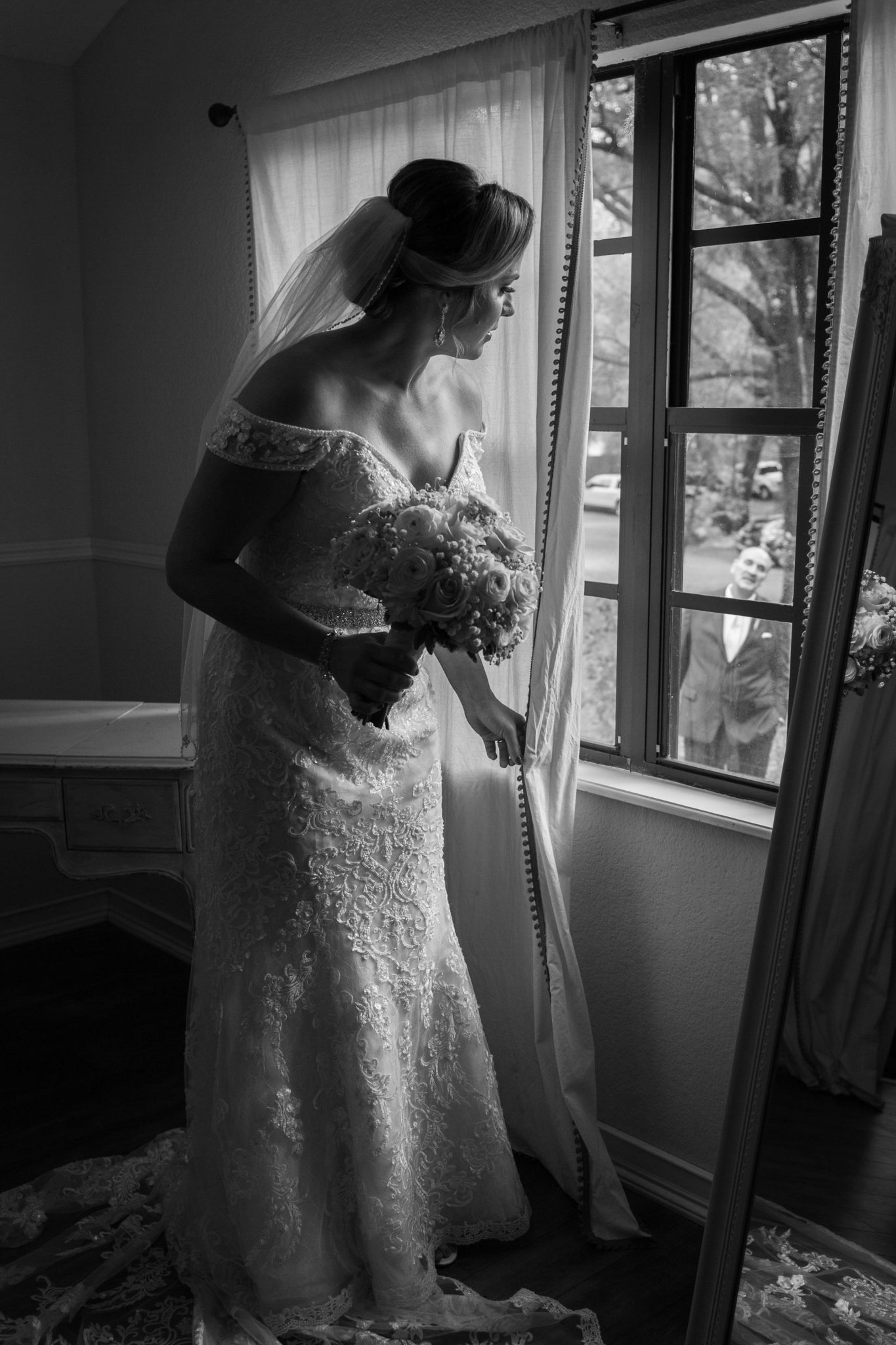 The bride seeing her father out the window.