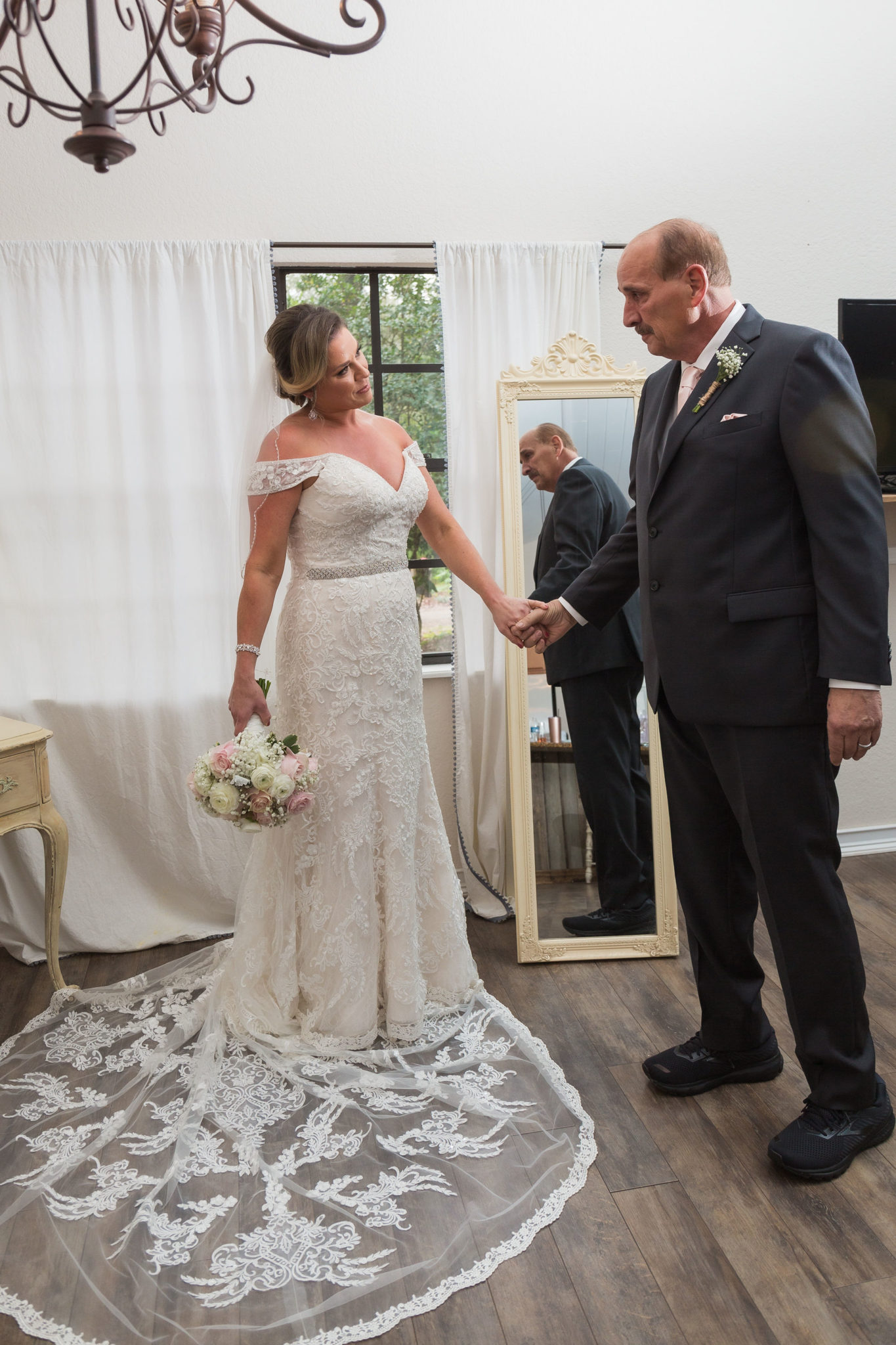 Father of the bride admiring how beautiful his daughter looks.