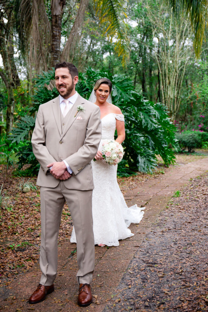 The bride sneaking up behind the groom for their first look.